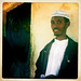 A Young Man Wearing A White Hat And Shirt Leaning Against The Wall, Degehabur, Somaliland