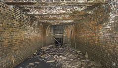 Industrial-grade tunnel (AnotherStepAway) Tags: light urban wet water river dark underground darkness exploring deep tunnel drain explore tunnels exploration culvert ue drainage urbex draining