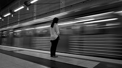 If you miss the train, catch the next one... (Michail Kalognomos) Tags: bw woman motion girl train still wideangle athens greece metrostation canoneos70d efs1018mmf4556isstm