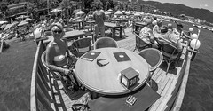 Icmeler, Turkey. A seaside sea view restaurant. (CWhatPhotos) Tags: cwhatphotos black white mono monochrome people cafe tables restaurante seaside view prom promanade icmeler near marmaris olympus samyang fisheye fish eye 75mm wide angle prime lens water holiday june 2015 photographs photograph pics pictures pic image images foto fotos photography artistic that have which contain digital bythe bikini blue turkey sea beach wear sand walk sky skies clear day hot sunny sun aegeon aegean turkish hols manual focus
