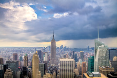 The Coming Storm: Rain and Shine in Midtown Manhattan (RBudhu) Tags: newyorkcity rain weather clouds rockefellercenter stormy timessquare empirestatebuilding gothamist bluehour statueofliberty gotham lowermanhattan topoftherock stormclouds 30rock gothamcity bankofamericatower midtownskyline newyorkcitysunset midtownmanhattanskyline empirestateofmind bluehournewyork