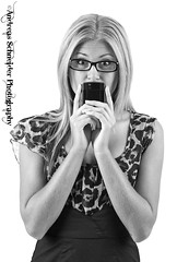 Young blonde woman with cell phone. (andreas_schneider) Tags: camera new woman black cute smile hair studio model eyes phone blackberry release stock cell business torch waterloo smartphone electronics blonde freckles launch rim touchscreen researchinmotion bb10