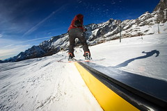 bsbslide_ (bass_nroll) Tags: blue sky mountain snow mountains canon out back focus freestyle board side rail slide fisheye snowboard trick rough 8mm rider snowboarder snowpark cervinia kink gibber gibbing 450d