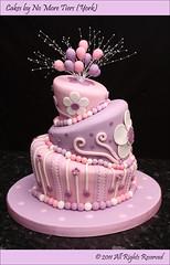 First go at a topsy turvy cake! (Cakes by No More Tiers (York)) Tags: pink purple balloon birthdaycake daisy mauve polkadot madhattercake celebrationcake topsyturvycake wonkycake yorkcakes heathercolour cakesbynomoretiers fionabrookcakes