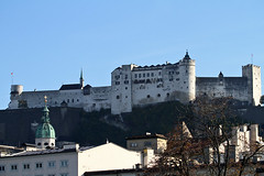 Festung Hohensalzburg overlooking the city. (lens buddy) Tags: holiday mountains alps salzburg castle skyline architecture austria cathedral towers churches cathedrals spire domes fortress mozart steeples palaces clocktowers festung festunghohensalzburg beautifulplaces monastries beautifulcities pathscaminhos eosdeurope