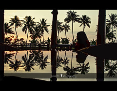 coconut trees, a woman and a reflecting dining table..(explored, frontpage) (PNike (Prashanth Naik..back after ages)) Tags: trees sunset sky orange woman sun india color reflection glass silhouette lady nikon asia view houseboat kerala symmetry backwaters alleppey cocount d7000 pnike