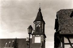 Weyersheim - Les trois crayons (joel lintz) Tags: street blackandwhite bw house film church analog pencil village noiretblanc asahi pentax k1000 nb alsace pentaxk1000 neopan crayon rue église lampadaire argentique colombage basrhin pellicule ultrafin weyersheim k1000asahi joëllintz