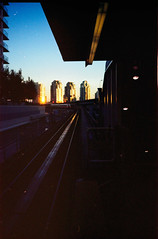 skytrain (Beaulawrence) Tags: camera winter canada color colour fall film station vancouver analog creek train buildings subway point toy lomography chinatown shoot december bc expo kodak grain platform columbia scan line plastic negative transportation transit commute automatic british konica asa elevated pocket skytrain translink portra compact false underexposed 160 c41 2011 mt7 sooc