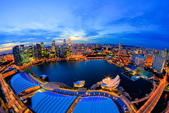 The World is Round (Shutter wide shut) Tags: longexposure skyline twilight singapore distorted dusk fisheye round 8mm hdr rafflesplace skyscapers starbursts marinabay singaporeskyline marinabaysands canoneos7d