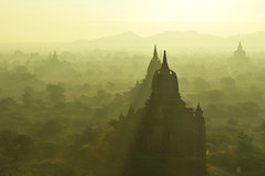 Silhouettes of Htilominlo Temple at Sunrise_HXT1592 (ohmytrip) Tags: morning horizontal fog architecture sunrise outdoors temple photography ancient day religion tranquility buddhism nopeople tourist spire valley remote myanmar bagan traveldestinations colorimage traditionallymyanmarian