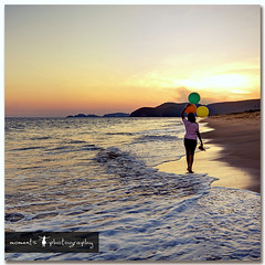 the simple pleasures of life.. (PNike (Prashanth Naik)) Tags: sunset sea sky woman india beach water colors lady balloons sand nikon asia hills vizag visakhapatnam d7000 pnike
