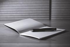 37/366 - Blank (aithom2) Tags: blackandwhite bw pencil notebook desk bokeh gray sketchbook depthoffield blank moleskin project366