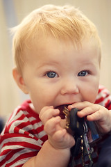 Everything is delicious nowadays (dana.nikolova (india-eve)) Tags: boy portrait baby cute face canon keys eos 50mm kid eyes hands toddler child sweet stripes blueeyes fingers naturallight blond 550d