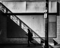 Street Light (Darren LoPrinzi) Tags: street city light urban bw woman philadelphia canon walking mono chinatown shadows centercity walk streetphotography sidewalk 5d canon5d philly abandonedstore