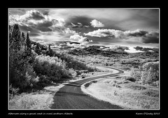 Afternoon along a gravel road in rural southern Alberta (kgogrady) Tags: road trees summer blackandwhite bw canada clouds rural fence landscape blackwhite nikon afternoon cattle country curves noone sunny ab nopeople hills alberta infrared nikkor gravel dx gravelroad westerncanada 2015 barbwirefence southernalberta d80 canadianlandscapes cans2s nikkor1870mmf3545gifed albertalandscapes picturesofalberta photosofalberta
