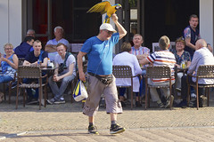 Parrotman crossing square (andzwe) Tags: people man holland haarlem netherlands animal nederland parrot plein grotemarkt papegaai parrotman panasonicdmcgh4