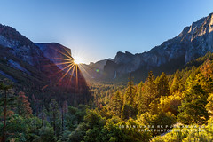 Illuminating the Valley (rkpunnamraju) Tags: travel trees light cloud sun mountain mountains nature skyline sunrise landscape nationalpark nps outdoor vibrant hills foliage nationalforest yosemite serene elcapitan tunnelview threebrothers haldome