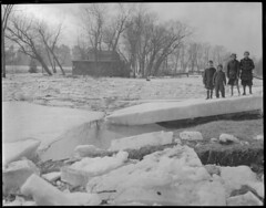 Kids survey flood water, New England flood (Boston Public Library) Tags: weather storms floods lesliejones