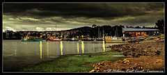 St Helens Harbour, early evening (darreng2011) Tags: ocean sky reflection beach water clouds dark boats lights restaurant harbor sand harbour jetty earlymorning overcast tasmania sthelens eastcoast boatramp