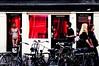 Red light district, Amsterdam (raphael.chekroun) Tags: red holland tourism girl amsterdam bike sex naked logo lights europe pentax prostitute tourist prostitution hooker redlightdistrict clients justpentax