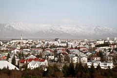 A View of Reykjavik (KatGatti) Tags: city travel horses urban sun fish mountains college skyline canon landscape iceland kat cityscape view reykjavik 7d perlan gatti bryn redroofs athyn