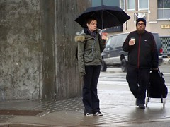 When Harry Met Sally (knightbefore_99) Tags: street winter black cold coffee rain station vancouver umbrella cafe cool niceshot candid toque grandview skytrain commercialdrive eastvan thedrive