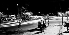 149/365. The City Never Sleeps (Anant N S) Tags: city longexposure light people blackandwhite bw india never art monochrome car photography amazing cool nikon exposure cityscape nightlights awesome trail lighttrails lesson awake conceptual nikkor insomnia sleeps day18 carlights pune tutorial unbelievable day149 artisticphotography 55200 cartrails project365 20secondexposure d3000 thecityneversleeps cityinthenight anantns thelensor anantnathsharma howtoshootalighttrail