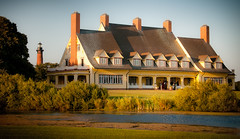 Whalehead Club (Sky Noir) Tags: travel light usa lighthouse beach yellow architecture club photography us sand warm unitedstates unitedstatesofamerica north shoreline artnouveau shore carolina romantic mansion outer banks hunt obx sandybeach countryhouse artsandcrafts currituck whalehead bybilldickinsonskynoircom