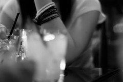 Thinking on Sangria (gracemlau) Tags: friends blackandwhite bw white black dinner lights glasses arm eating meals drinks conversation bracelets sangria greyscale ambiance