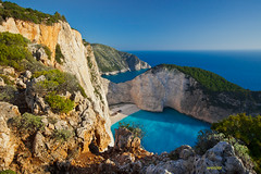 Hidden Treasure?? (Chris Weisler) Tags: ocean blue sea bw seascape beach water canon landscape greek bay europe ship euro teal cigarette cliffs greece shipwreck ii 5d polarizer gitzo mk tabaco zante zakynthos ionian panagiotis navagio 1635mm mygearandme