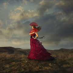 Lady In Red - Dama De Rojo (trini61) Tags: red sky mountains fashion clouds fan dress windy spanish breeze flamenco ladyinred abanico lesbrumes