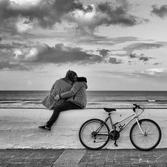 Ensemble (Christophe Rettien) Tags: sea two bw love beach bike bicycle wall delete10 clouds delete9 delete5 delete2 kissing couple delete6 delete7 horizon save3 delete8 delete3 delete delete4 save save2 lovers save4 twopeople