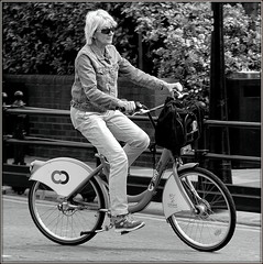 Springtime cycling (* RICHARD M (5 million views)) Tags: street sunglasses bike bicycle liverpool happy mono bicycling cycling blackwhite spring cyclist exercise action candid transport may happiness shades sneakers trainers unescoworldheritagesite jeans cycle blonde bicyclist bikeride albertdock denimjacket springtime bikeriding merseyside bikerider capitalofculture citybike europeancapitalofculture sunspecs greentravel liverpoolcitycouncil healthyoption greenoption blondeonbike blonderidingbike unescocityofmusic unescomaritimemercantilecity blondecyclist blondebicyclist