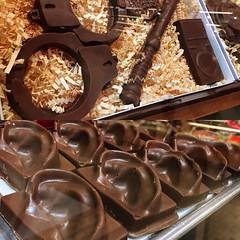 @inkainsf #chocolate ears & police gear. (jennifer_loring) Tags: philadelphia square pennsylvania squareformat snapshots unprocessed readingterminalmarket iphoneography instagramapp uploaded:by=instagram
