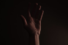 hand (therobotician) Tags: light shadow contrast dark person photo moody fuji hand natural bright body indoors human fujifilm dim tones chiaroscuro harsh x100