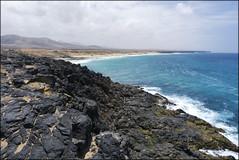 Playa del Castillo - El Cotillo, Fuerteventura (JLL85) Tags: blue sea españa costa mountain seascape sol beach azul landscape coast mar spain cloudy fuerteventura playa paisaje nubes montaña seashore acantilado cotillo
