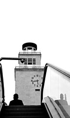 emerging (piazza vittoria - brescia, italy) (bloodybee) Tags: street people bw italy man building tower clock silhouette stairs underground subway europe metro watch escalator brescia piazzavittoria 365project torredellarivoluzione