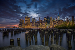 Skyline of New York City (roken-roliko) Tags: city newyorkcity longexposure nightphotography travel sky architecture night clouds buildings river lights cityscape towers panoramic northamerica bluehour polls nycskyline traveldestinations newyorkcityskyline cityandarchitecture rolandshainidze