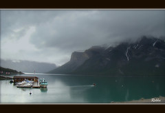Lake Minnewanka (Rekha Prasad) Tags: cruise lake canada nature water landscape boat interestingness cloudy peaceful tranquility explore alberta serenity banff 217 banffnationalpark lakeminnewanka canadianrockies minnewanka amazingplace flickrexplore breathtakingview explored mostscenic dec42011 scenicplaceinnorthamerica