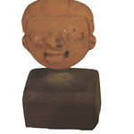 "<b>711</b><br/> ""Small Face Mounted on Wood Base""  Clay, n.d. (Pre-Columbian) LFAC #711<a href=""http://farm8.static.flickr.com/7003/6466102853_766e52538d_o.jpg"" title=""High res"">∝</a>"