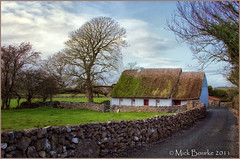 Traditional Irish thatched Cottage Maree Oranmore Galway Ireland. (Mick Bourke.) Tags: road trees ireland roof sky irish building galway canon heather traditional rustic cottage shed straw vegetation rushes oranmore wal method maree thatched thatching layering sedge thatchedcottage canon24105f4lis canon60d waterreed mickbourke