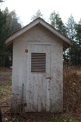 The outhouse behind the golf course
