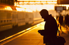 Forever Delayed (Rob Kints (Robk1964)) Tags: sun sunlight station silhouette mobile train delay waiting dof phone bokeh perron platform tracks thenetherlands railway denhaag getty thehague sms manicstreetpreachers wachten tegenlicht texting treinstation vertraging hollandsspoor