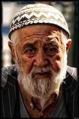Distinctive (Gerard Schuur) Tags: street city portrait people man hat turkey beard thought citylife streetlife istanbul capitol wise gentleman distinctive trainofthoughts peoplism