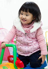 little girl playing (wu.peng) Tags: boy playing girl childhood smiling comfortable asian fun toy happy person japanese infant colorful child emotion expression small adorable indoor plastic indoors blanket laugh innocence lovely joyful relaxation toycar littlegirls bodycare humanface fineartportrait 23years