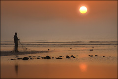 One with nature (adrians_art) Tags: mist beach fog sunrise reflections sussex coast fishing fisherman sand rocks silhouettes shore nets seawater pettlevels