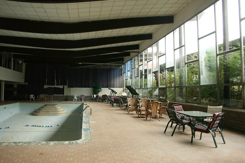 Indoor pool building windows and deck chairs