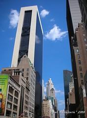 Solow Building (Paul's Captures (paul-mashburn.artistwebsites.com)) Tags: newyork reflections centralpark bluesky godzilla hudsonriver glassbuildings solowbuilding 17statestreet horsecarriages