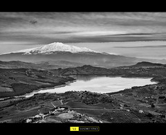 The Volcano and the Lake (Sandro V-R ) Tags: white lake clouds landscape volcano photo nikon foto occhi neve sharpen etna sicilia sandro spettacolo contrasto lenti d80 the4elements lagodipozzillo nikonflickraward sicilianlandscape sandrovinci