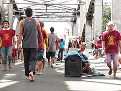 people (devotees) (dolcevitalux) Tags: people baby tourism smile face umbrella children child jeep blind finger beggar barefoot manila devotion persons frown devotee jeepney sacrifice quiapo jesuschrist penitence nazarene everydaypeople blacknazarene dirtyfinger dolcevitalux